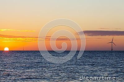 Offshore wind turbine at sunrise
