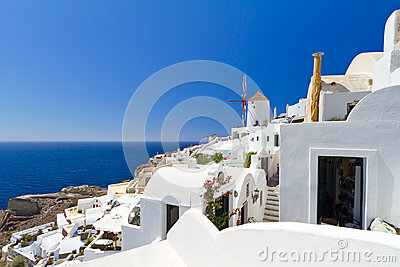 Oia village on Santorini with white windmill