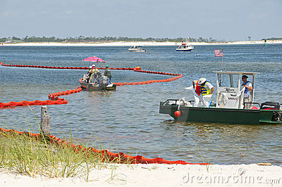 Oil boom to protect beach Editorial Stock Image