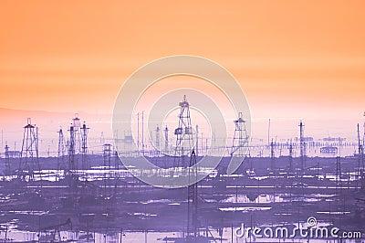 Oil derricks on early morning