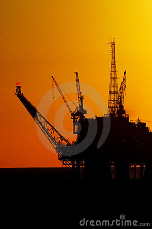 Oil Drilling rig in silhouete
