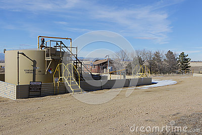 Oil Fracking Rig close to a home in Colorado Editorial Photography