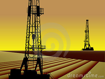 OIL GAS DRILLING RIGS AT SUNSET