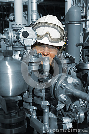 Oil and gas worker with machinery