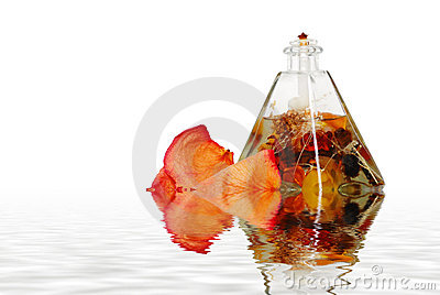 Oil lamp and rose petals with water