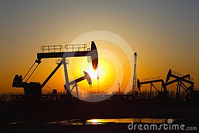 Oil pump against setting sun