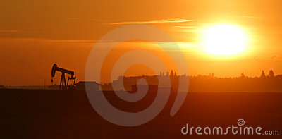 Oil pump jack at sunrise