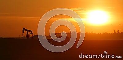Oil pump jack at sunrise