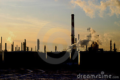 Oil refinery silhouetted