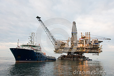 Oil rig being tugged