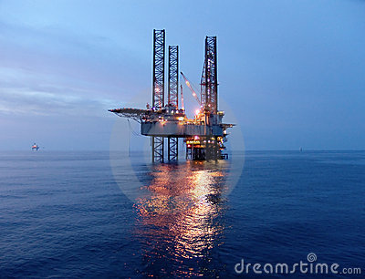Oil rig before sunrise