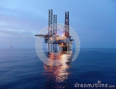 Oil rig before sunrise