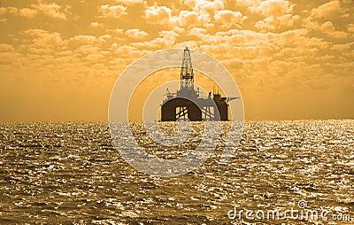 Oil rig during sunset in Caspi