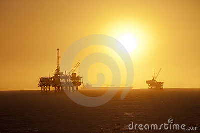 Oil rigs at sunset.