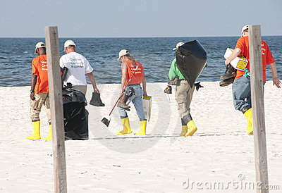 Oil spill workers at seashore Editorial Photography