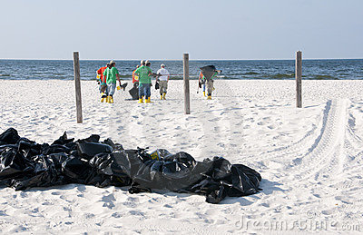 Oil spill workers at seashore Editorial Stock Image