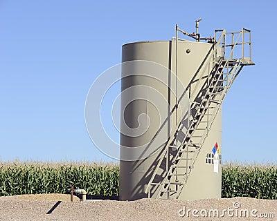 Oil storage tank in maize field
