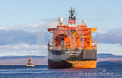 Oil Tanker With Tug Editorial Photo