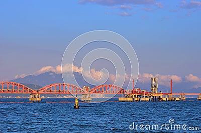 Oil transfer pipe line on sea under sunset light