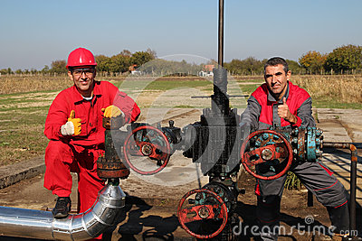 Oil Well and Two Oil Workers