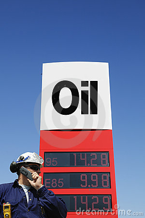 Oil-worker and fuel sign