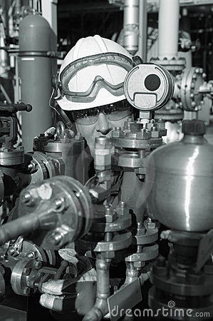 Oil worker and refinery pipes
