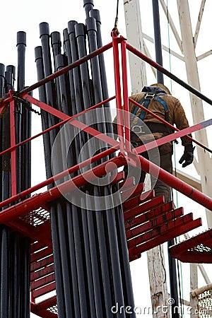 Oil worker on scaffold