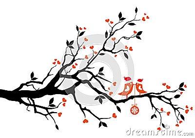 Oiseaux de Santa embrassant sur un arbre,