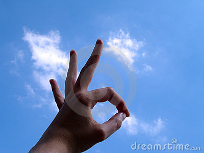 Ok Sign with cloud background