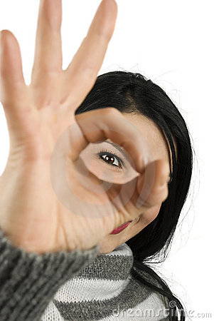 Ok sign woman eye