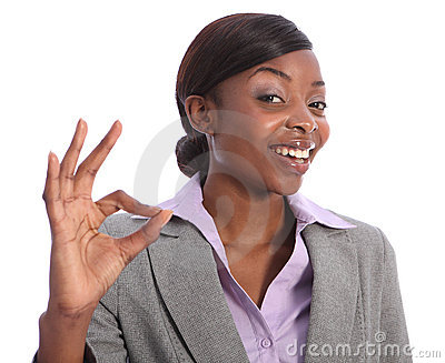 Okay hand sign by happy african american woman
