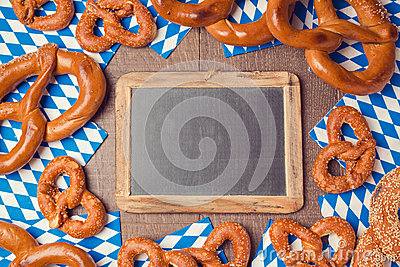 Oktoberfest german beer festival background with chalkboard and pretzel Stock Photo