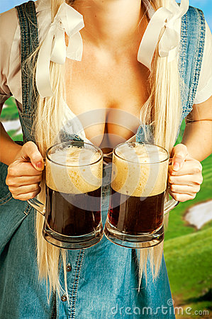 Free Oktoberfest Woman Holding Two Beer Mugs Royalty Free Stock Photo - 43931975