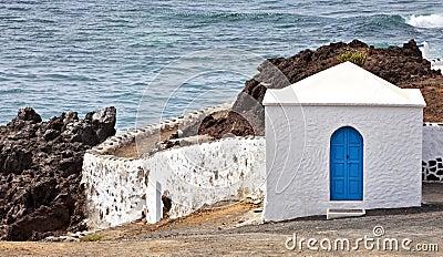 Olcanic coastline with elegant house, El Golfo
