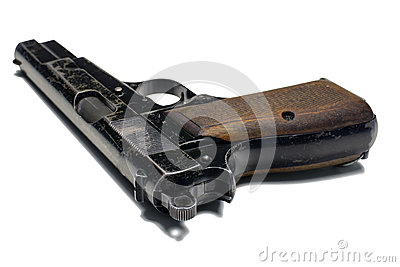 Old 9 mm pistol close up on white background