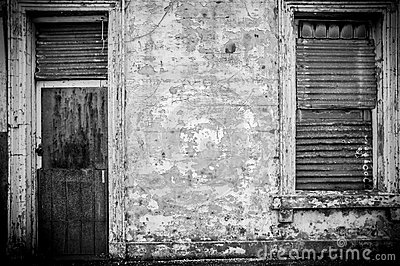 Old abandoned building with corrugated iron door
