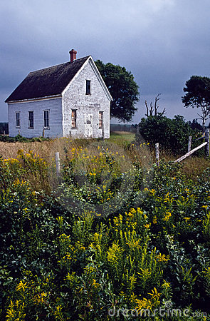 Old abandoned schoolhouse in a rural field