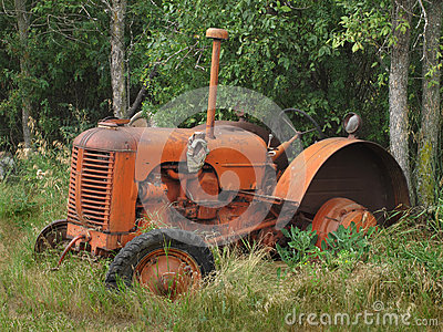 Old abandoned small farm tractor