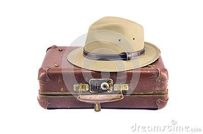 Old aged suitcase for traveling and hat isolated on white