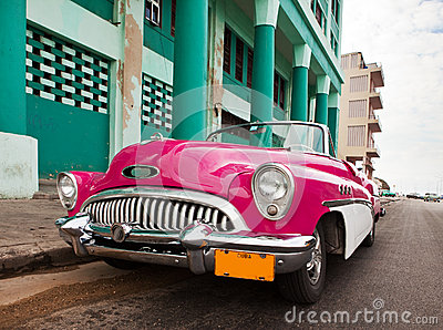 Old American retro car (50th years of the last century), an iconic sight in the city, on the Malecon street January 27, 2013 in O
