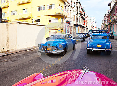 Old American retro cars on the  street January 27, 2013 in Old  Havana, Cuba Editorial Stock Photo