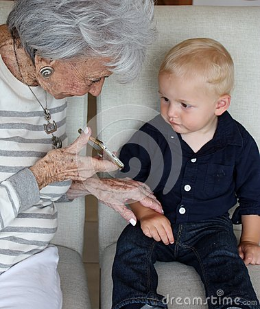 Free Old And Young Enjoying Modern Technology Stock Photos - 56085003