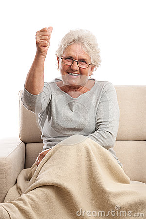 Old angry woman smiling and threatening with fist