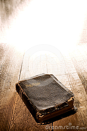 Old Antique and Damaged Holy Bible in Divine Light