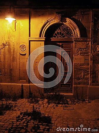 Old antique door at night