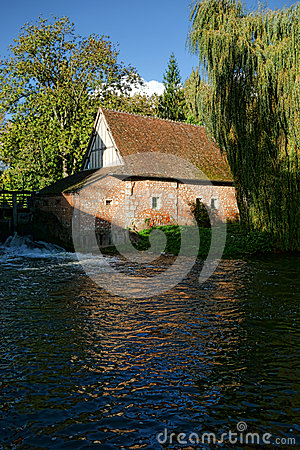 Old Antique Mill with Weeping Willow on a River