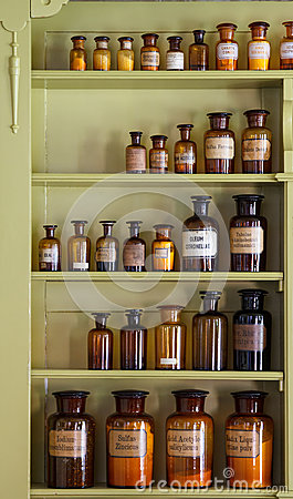Free Old Apothecary Cabinet With Storage Jars Royalty Free Stock Photography - 27443377