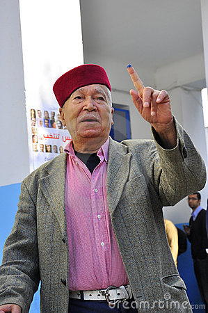 Old arab man who voted, traditionally dressed Editorial Stock Image