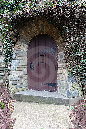 Old arched wooden door Franciscan Monastery