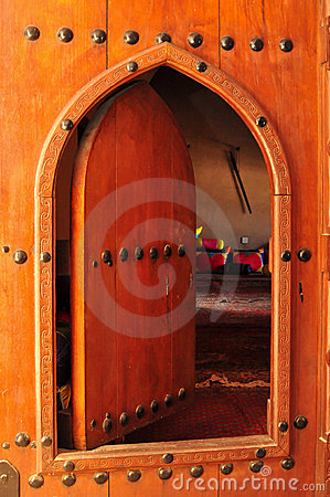 Old arched wooden doorway